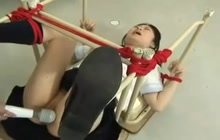 Tied Japanese girl gets toyed