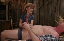Blondie strapon fucking a guy in a barn